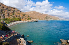 CRETE,GREECE-JULY 23:Tourists go downstairs to the Preveli Beach on July 23,2014 on Crete,Greece. The beach of Preveli is situated Stock Images