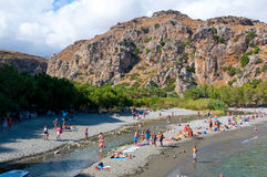 CRETE,GREECE-JULY 23:Tourists have a rest on the Preveli Beach on July 23,2014 on Crete, Greece. The beach of Preveli is situated Royalty Free Stock Images