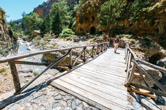 Tourists hike in Samaria Gorge in central Crete, Greece. The national park is a UNESCO Biosphere Rese Stock Images