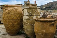 CRETE, GREECE - November, 2017: Ancient amphorae at Knossos palace, Crete. Crete, Greece - November, 2017: Close-up - three ancient amphorae, in the background Stock Image