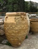 CRETE, GREECE - November, 2017: Ancient amphorae at Knossos palace, Crete. Crete, Greece - November, 2017: Close-up - three ancient amphorae, in the background Stock Photography