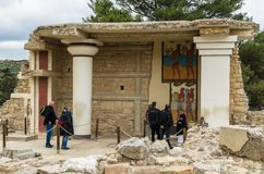 CRETE, GREECE - November, 2017: ancient ruines of famouse Knosso. CRETE, GREECE - November, 2017: tourists looking at the scenic ruins of the Minoan Palace of Royalty Free Stock Photography
