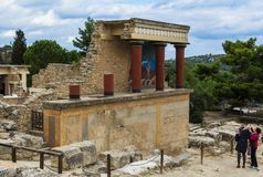 CRETE, GREECE - November, 2017: ancient ruines of famouse Knossos palace at Crete. CRETE, GREECE - November, 2017: Tourists looking at the scenic ruins of the Royalty Free Stock Photos