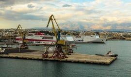 Crete, Greece - November 2, 2017: Panoramic view on the cargo port and the city of Heraklion. Heraklion, Crete, Greece - November 2, 2017: In the foreground Royalty Free Stock Photos