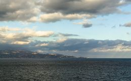 Crete, Greece - November 2, 2017: Panoramic view on the Crete. Crete, Greece - November 2, 2017: Panoramic view on the island of Crete in the rays of the rising Royalty Free Stock Photos