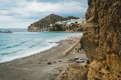 Crete, Greece. View from cliffs to village with marine vessels, boats and lighthouse. View from cliff on Bay with beach. And architecture - vacation destination royalty free stock photos