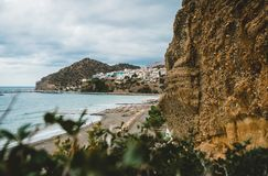 Crete, Greece. View from cliffs to village with marine vessels, boats and lighthouse. View from cliff on Bay with beach. And architecture - vacation destination stock photo