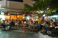 CRETE,HERAKLION-JULY 24: People at the local restaurant on Lions Square on July 24,2014 on the Cete island, Greece. Stock Photos