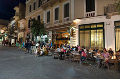 CRETE,HERAKLION-JULY 24: People in a  local restaurant next to Lions Square on July 24,2014 on the Cete island in Greece. Royalty Free Stock Image