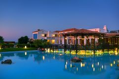 CRETE ISLAND, GREECE, JULY 01, 2011: Night view on Royal Mare Village restaurant for tourists and guests. Classical Greek hotel ar Stock Images