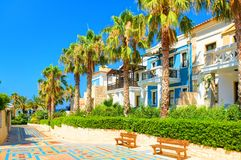 CRETE ISLAND, GREECE, JULY 01, 2011: View on hotel tropical villas for tourists guests. Green tropical palm trees. Classic luxury royalty free stock photo