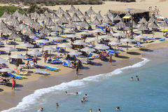 Crete island, Palm beach Vai, Greece - August 24, 2015. People sunbathing on the beach. People sunbathing and having a rest on the beach Stock Photography