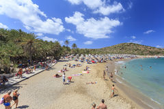 Crete island, Palm beach Vai, Greece - August 24, 2015. People sunbathing on the beach. People sunbathing and having a rest on the beach Stock Image