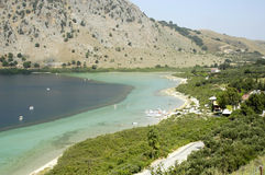 Crete Lake Kournas. With sailing boats and mountain Stock Images