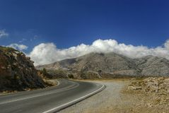 Crete. Lonely road. Mountain empty road. Crete, Lasithi plateau Royalty Free Stock Photos
