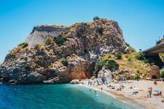 People have a rest at sea bay of Palaiokastro town with beautiful beach on Crete island, Greec Stock Photo