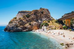 People have a rest at sea bay of Palaiokastro town with beautiful beach on Crete island, Greec Royalty Free Stock Image