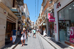 CRETE,RETHYMNO-JULY 23:Shopping Arkadiou street on July 23,2014 in Rethymnon city on the island of Crete, Greece. Arkadiou Street Royalty Free Stock Photography