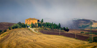 Crete Senesi landscape in Tuscany, Italy on a foggy dawn Royalty Free Stock Photo