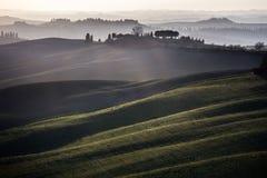 Crete senesi, toczny wzgórze zmierzch. Tuscany, Włochy Zdjęcia Royalty Free