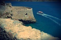 Crete - Spinalonga - island of lepers. Venetian fort. nSurrounded by the emerald waters of Mirabello Bay. Tourism Stock Photo