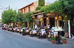 Creten Dinner Time. HERSONISSOS, GREECE - JULY 22, 2014: Creten Dinner Time - People eating dinner outdoors in Greek Tavernas at Hersonissos Old City Square in Stock Images