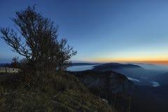 Creux-du-Van or Creux du Van: Rocky Amphitheater before sunrise. Canton Neuchatel, Switzerland Royalty Free Stock Photo