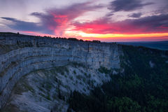 Creux du Van lit by the last sunrays Royalty Free Stock Photography