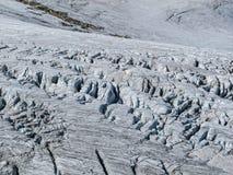 Crevasses in a glacier. Crevasses in a alpine glacier.  The glacier has no snow on it Royalty Free Stock Images