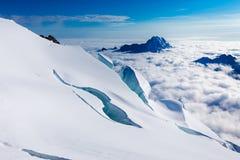 Crevasses mountains peaks clouds Huayna Potosi , Bolivia tourism Stock Photos