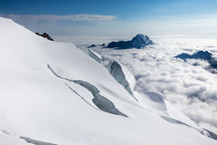 Crevasses mountains peaks clouds Huayna Potosi , Bolivia tourism Royalty Free Stock Photography