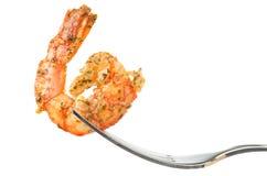 Crevette goupillée sur une fourchette photographie stock libre de droits
