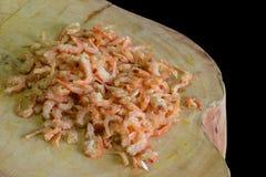Crevette sur une planche à découper Photo stock