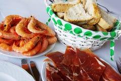 Crevettes et lard Photo stock
