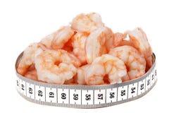 Crevettes et mètre Photos stock