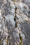 Crevice in a cliff Stock Images