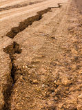 Crevice dirt road. Which broke off from water erosion below Royalty Free Stock Image