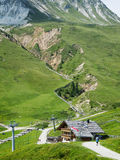 Crevice by mountain guesthouse Stock Photography