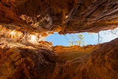 Crevice in wall of Providence Canyon, USA. Crevice in the red loamy wall of Providence Canyon bottom view in sunny day, USA Royalty Free Stock Photo