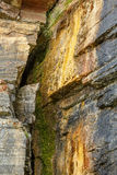 Crevice on a rock. With dripping water Stock Photo
