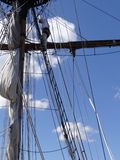 Crew adjust the rigging and sails of the Lady Washington Stock Images
