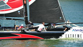Crew of Alinghi team steering boat at Extreme Sailing Series Singapore 2013 Royalty Free Stock Photo