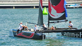 Crew of Alinghi team steering boat at Extreme Sailing Series Singapore 2013 Royalty Free Stock Photos