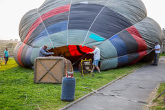 Crew, assembly and filling the hot air balloon Royalty Free Stock Photo