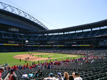 Crew cleans field and people fill into seats at Safeco Field Royalty Free Stock Photo