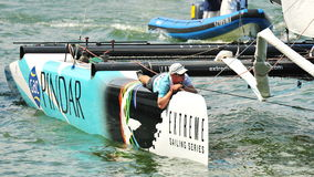 Crew of GAC Pindar steering boat at Extreme Sailing Series Singapore 2013 Stock Photos