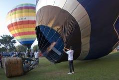 Crew holds open balloon envelope Stock Photo