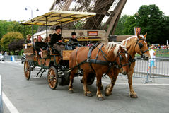 Crew. Horse-drawn carriage rolls of people near the Eiffel tower photo of 2012 Paris Royalty Free Stock Photos