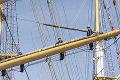 Crew of the Krusenstern ship stand on sail mast. Tallinn, Estonia - July 12, 2013: Kruzenshtern or Krusenstern ship stand on sail masts while the ship enters Stock Photography