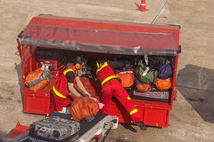 Crew loading checked baggage Stock Photos